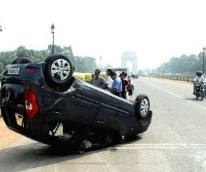 Car turns turtle near India Gate