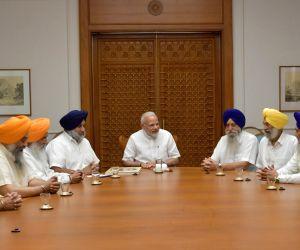 SGPC delegation calls on Modi