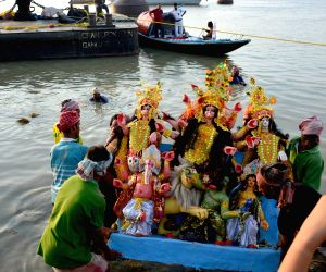 a-durga-idol-being-immersed-in-hooghly-river