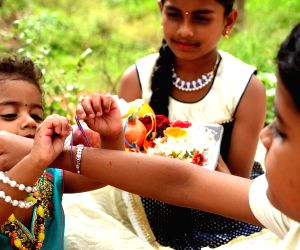 a-girl-ties-rakhi-on-the-wrist-of-her-brother-on