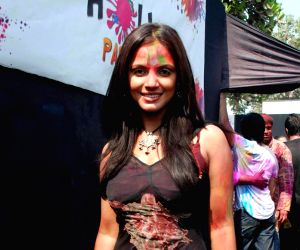 A guest at the Zoom Tv Holi bash.