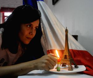 Candle for the victims of 13/11 Paris blasts
