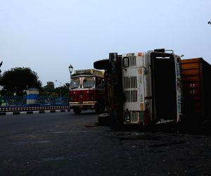 Truck rollovers near Raj Bhavan