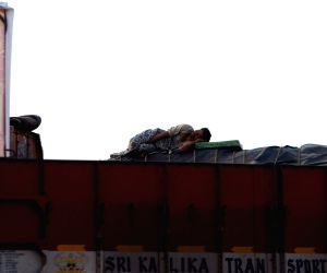 A man enjoys his siesta​ atop a truck