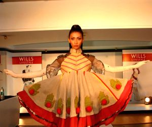 """A Model showcasing Fashion Student's creative design at the finale of  """" The Debut"""" By Wills Lifestyle,In New Delhi On Thursday."""
