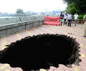 A Mumbai footpath caves-in after rains