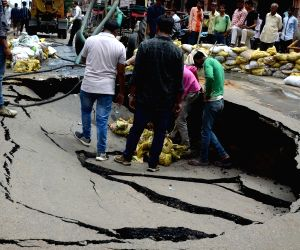 Road caves in at Ghat Gate Bazar