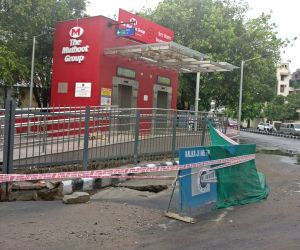 Road outside GK Metro station caves in