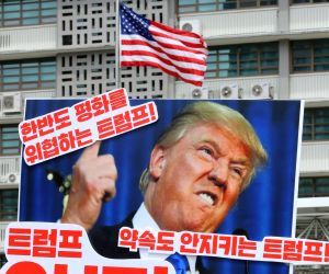 "A protester holds a banner that says, ""Trump jeopardizes peace on the Korean Peninsula,"" during a rally in front of the U.S. Embassy in Seoul on May 25, 2018, to criticize the U.S. ..."