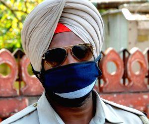 Punjab police personnel honour ASI Harjeet Singh, wear his name on their badges