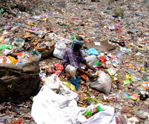 Eve of World Environment Day -  Rag picker collects recyclable items from garbage