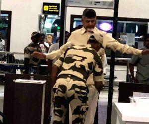 A security personal frisks Former Andhra Pradesh Chief Minister and now leader of opposition N. Chandrababu Naidu at Gannavaram Airport in Vijayawada, on June 14, 2019. The Telugu Desam ...