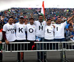 Kohli-Dhoni names on fans' shirts get ICC to tweet smartly