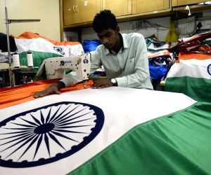A tailor busy making the national flag