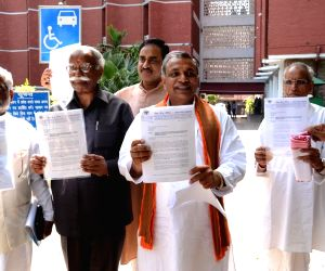 A VHP delegation comes out of Election Commission`s office after meeting Chief Election Commissioner V S Sampath regarding Muslim appeasement policies of the UPA government and alleged violation of ..