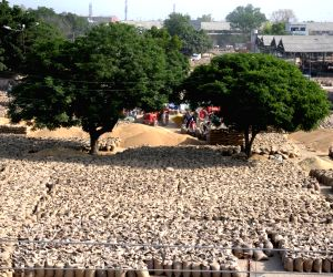 Workers winnows grains in Amritsar