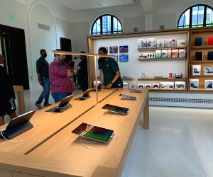 "A view of the Apple Carnegie Library store in Washington DC, USA. Apple spent *neatly* $30 million to restore and revitalise historic Carnegie Library, a 1903 Beaux-Arts building at Mount Vernon Square in Washington, DC. Billed as ""Apple's"