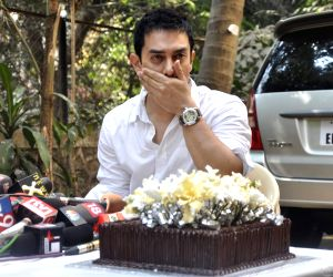 Aamir Khan gestures as he interacts with the media on his 45rd birthday at his home in Mumbai.
