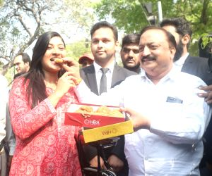 AAP MLA Alka Lamba celebrates after Delhi High Court restored the Assembly membership of 20 ruling party MLAs who were disqualified for holding office-of-profit in New Delhi, on March 23, ...