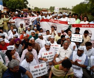 AAP workers led by Sanjay Singh participate in a demonstration in support of Delhi Chief Minister Arvind Kejriwal at Raj Ghat in New Delhi, on June 14, 2018.