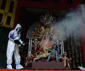 Durga Puja pandal being sanitised amid COVID-19 pandemic
