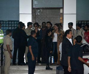 Actor Aamir Khan and his wife Kiran Rao, actor Shah Rukh Khan and filmmaker Karan Johar arrive in Mumbai after attending the pre-wedding celebrations of Isha Ambani and Anand Piramal in ...