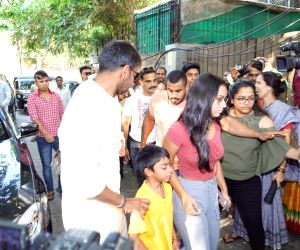 Ajay Devgn, Yug Devgn and Nyse Devgn seen at a cinema theater