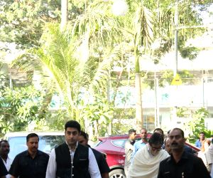 Actor Amitabh Bachchan and his son-actor Abhishek Bachchan arrive at the prayer meet organised for late veteran action director Veeru Devgan, in Mumbai, on May 30, 2019.