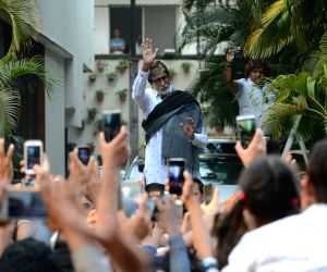 Actor Amitabh Bachchan greets his fans from his residence in Juhu, Mumbai on March 25, 2018.