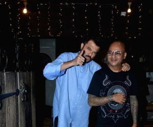 Actor Anil Kapoor and celebrity hairstylist Aalim Hakim seen at a Bandra salon, in Mumbai on Feb 20, 2019.