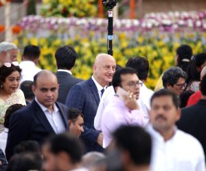 Actor Anupam Kher with his wife and Chandigarh BJP MP Kirron Kher at Prime Minister Narendra Modi and his new cabinet's oath-taking ceremony at the Rashtrapati Bhavan in New Delhi on May ...