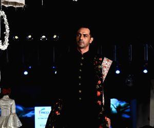 Actor  Arjun Rampal walks on the ramp for fashion designers Abu Jani and Sandeep Khosla' show Khadi Goes Global - celebrate 100 years of Khadi, in New Delhi on Feb. 21, 2019.