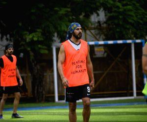 Abhishek Bachchan, Dino Morea during a football match