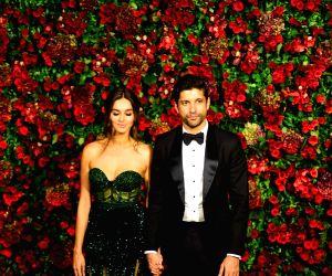 Actor Farhan Akhtar with rumoured girlfriend Shibani Dandekar arrive at Ranveer Singh and Deepika Padukone's wedding reception at Grand Hyatt hotel in Mumbai on Dec 1, 2018.