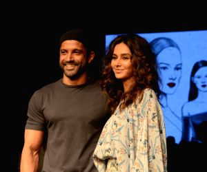 Actor Farhan Akhtar with Shibani Dandekar. (Photo: IANS)