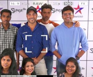 """Actor Hrithik Roshan, whose movie """"Super 30"""" will be premiering on television soon, photobombed fans who were recording special messages for him and posing next to his movie's poster."""