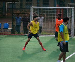 Dhoni, Ishaan and Aditya playing football at bandra