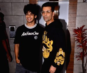 "Actor Ishaan Khatter and filmmaker Karan Johar during the success party of their film ""Dhadak"" in Mumbai on Aug 9, 2018."