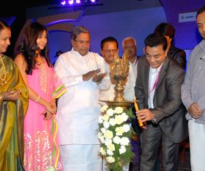 Siddaramaiah with actors Kamal Haasan, Ramesh Arvind and Sudeep during inauguration of Bangalore International Film Festival