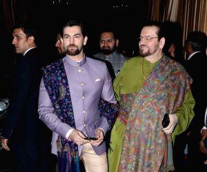 Actor Neil Nitin Mukesh with his father and singer Nitin Mukesh at the wedding reception of industrialist Mukesh Ambani's daughter Isha Ambani and Anand Piramal in Mumbai on Dec 14, 2018.