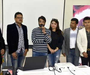 Prosenjit Chatterjee, Pallavi Chatterjee, Srimanta Chatterjee during a program