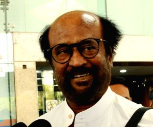 Actor Rajinikanth talks to media persons at the Indira Gandhi International Airport on his arrival in New Delhi to attend Prime Minister Narendra Modi's swearing-in ceremony, on May 30, ...