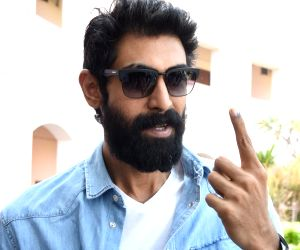 Actor Rana Daggubati shows his inked finger after casting his vote for Telangana Assembly elections in Hyderabad on Dec 7, 2018.
