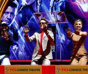 Actor Robert Downey Jr. (C) , Chris Evans (L) and actress Scarlett Johansson. (File Photo: Xinhua/Li Ying/IANS)