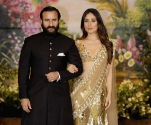 Actor Saif Ali Khan along with his wife and actress Kareena Kapoor Khan at the wedding reception of actress Sonam Kapoor and businessman Anand Ahuja in Mumbai on May 8, 2018.