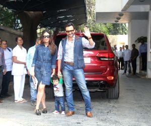 Actor Saif Ali Khan along with his wife Kareena Kapoor Khan and son Taimur at Shashi Kapoor's Christmas Party held at his residence in Mumbai on Dec 25, 2017.