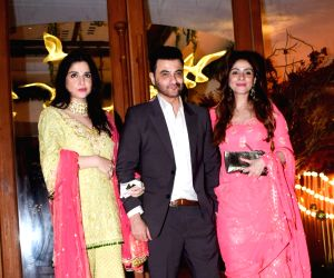 Sanjay Kapoor and Maheep Sandhu at a wedding reception