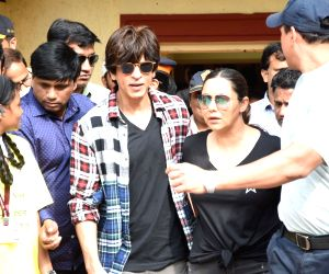Actor Shah Rukh Khan and his wife Gauri arrive to cast their votes for Maharashtra Assembly elections, at a Bandra polling station in Mumbai on Oct 21, 2019.