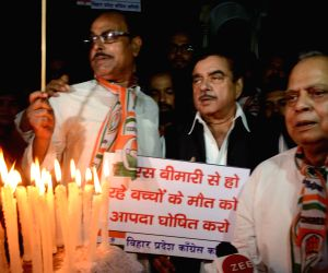 Actor turned politician Shatrughan Sinha participates in a candlelight vigil after 107 children died in Bihar due to Acute Encephalitis Syndrome (AES); in Patna on June 18, 2019.