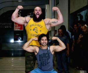 Varun Dhawan and Braun Strowman seen at a gym